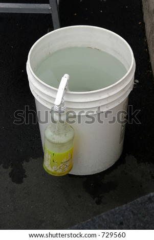 bucket of water with squirt bottle at a car wash