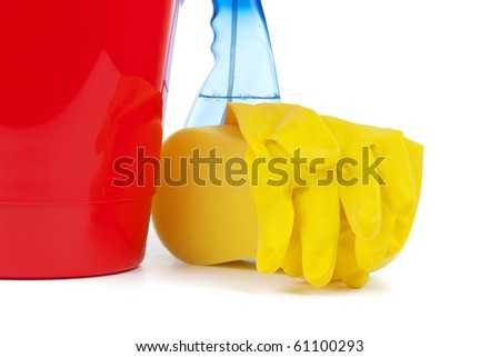 bucket, sponge, rubber gloves, detergent spray bottle on white background closeup
