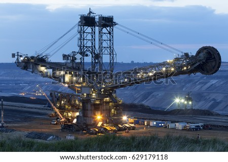 bucket wheel excavator under repair in the evening