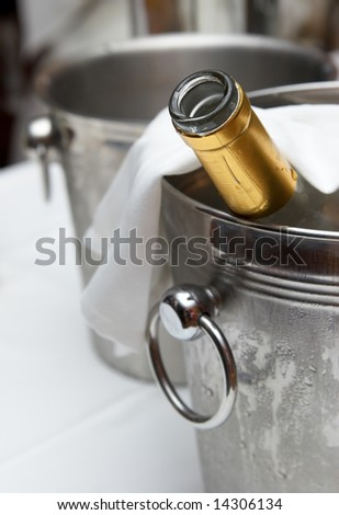 Bucket with an ice for cooling drinks