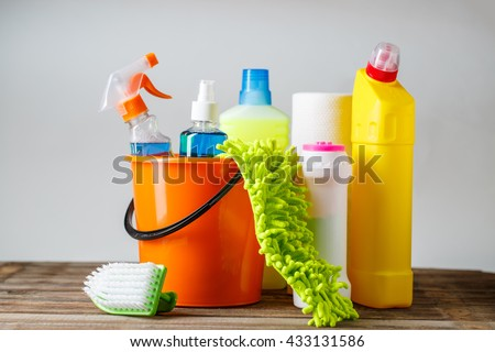 Bucket with cleaning items on light background #433131586