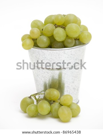 bucket with green grapes