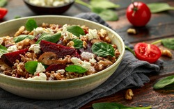 Buckwheat and beetroot salad with mushroom, walnut, spinach and feta cheese. healthy diet food