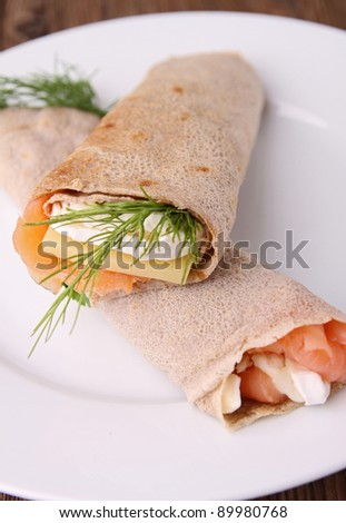 buckwheat crepe with salmon and cheese