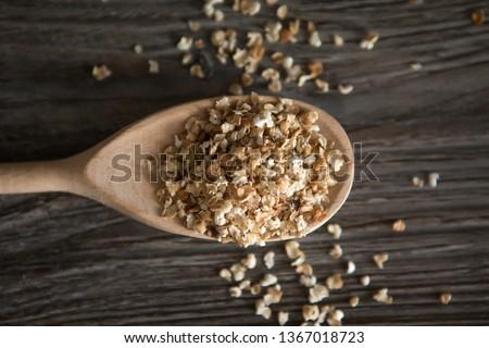 buckwheat flakes, oat flakes on wooden background,Buckwheat flakes on a wooden background #1367018723