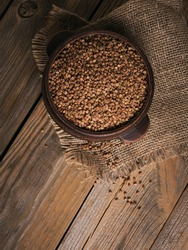 Buckwheat groats top view. Grains of raw buckwheat as a background texture.