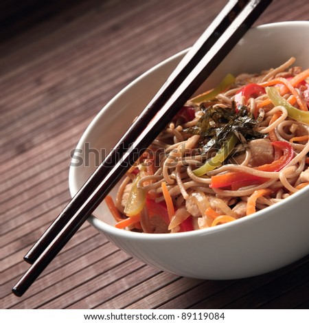 Buckwheat noodles with chicken and vegetables in Japanese style #89119084