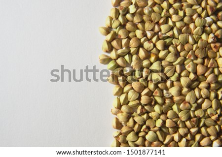 Buckwheat seeds on white background occupying the right half of the photo. It contains the essential amino acids. It does not contain gluten.