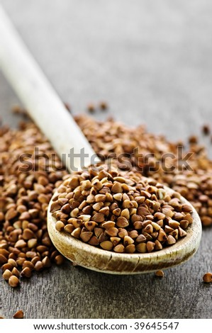 Buckwheat seeds on wooden spoon in closeup