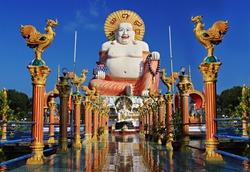 Budai or Pu-Tai or Happy Buddha or Laughing Big Buddha statue at Wat Plai Laem Temple in the Ko-Samui or Samui island in Thailand