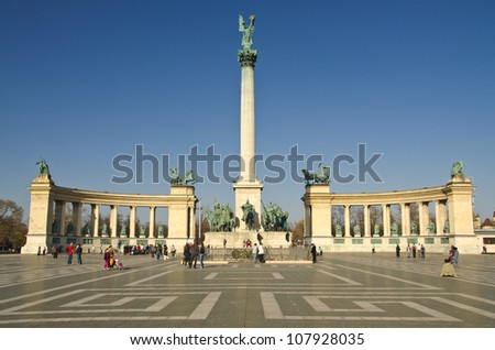 BUDAPEST - CIRCA MAR 2012: Tourists visit Millennium Monument in Heroes Square circa March 2012 in Budapest, Hungary. This square has been UNESCO World Heritage site since 2002.