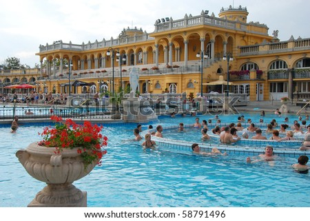 BUDAPEST - CIRCA SEPTEMBER 2009: People bathe in the Szechenyi spa circa September 2009 in Budapest. Szechenyi Medicinal Bath is the largest medicinal bath in Europe.