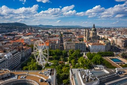 Budapest, Hungary - Aerial drone view of the downtown of Budapest on a sunny summer day. This view includes Elisabeth Square with ferris wheel, St. Stephen's Basilica and Hungarian Parliament building