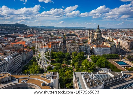 Photo of  Budapest, Hungary - Aerial drone view of the downtown of Budapest on a sunny summer day. This view includes Elisabeth Square with ferris wheel, St. Stephen's Basilica and Hungarian Parliament building