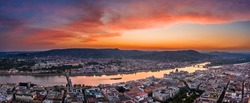 Budapest, Hungary - Aerial panoramic skyline view of Budapest with a dramatic colorful sunset and parliament building, Szechenyi Chain Bridge, Buda Castle Royal Palace, Buda Hills and Margaret Island