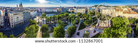 Budapest, Hungary - Aerial panoramic view of Elisabeth square (Erzsebet ter) at sunrise. This view includes St.Stephen's Basilica, Deak Square, Parliament, Buda Castle Royal Palace, Statue of Liberty