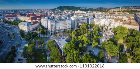 Budapest, Hungary - Aerial panoramic view of Elisabeth Square (Erzsebet ter) at sunrise with Deak Square, Statue of Liberty and Buda Castle Royal Palace at background