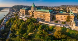 Budapest, Hungary - Aerial panoramic view of the beautiful Buda Castle Royal Palace at sunrise with Gellert Hill and Statue of Liberty at background