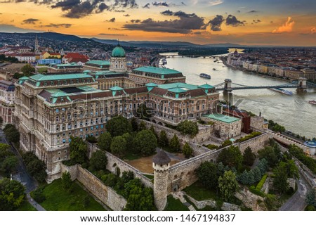 Budapest, Hungary - Aerial skyline view of Buda Castle Royal Palace with Szechenyi Chain Bridge, Matthias Church and Parliament building with a beautiful golden sunset at summer time #1467194837