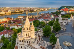 Budapest, Hungary - Aerial view of Fisherman's Bastion at sunset with Szechenyi Chain Bridge, St.Stephen's Basilica and Buda Castle Royal Palace at background on a sunny summer afternoon