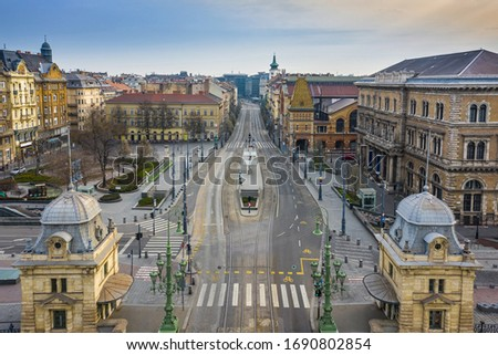 Budapest, Hungary - Aerial view of Fovam square and totally empty streets at Vamhaz Boulevard (Vamhaz korut) and Central Market Hall. No people on the streets of Budapest on a Spring morning