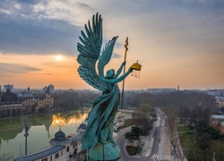 Budapest, Hungary - Aerial view of Gabriel Archangel at Heroes' Square during the 2020 Coronavirus quarantine in the morning. Vajdahunyad Castle and City Park at background with a warm sunrise