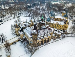 Budapest, Hungary - Aerial view of the beautiful Vajdahunyad Castle and Museum of Hungarian Agriculture in the snowy City Park (Varosliget) at winter time