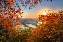 Budapest, Hungary - Autumn in Budapest. Liberty Bridge (Szabadsag Hid) at sunrise with beautiful autumn foliage