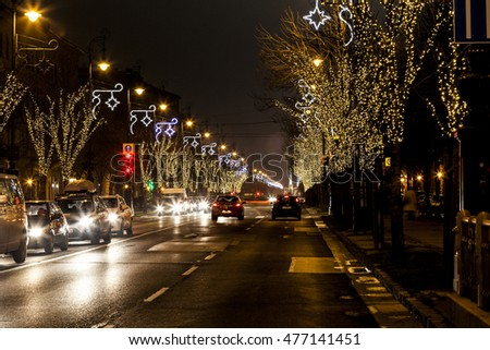 BUDAPEST, HUNGARY - DEC 19 2015: Tourists enjoy the Christmas spirit and the light show in down town Budapest. This traditional Christmas fair attracts over million visitors each year. #477141451