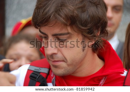 BUDAPEST, HUNGARY -  JULY 29: F1 driver Fernando Alonso is among his fans and giving autographs on July 29, 2011 in Budapest.