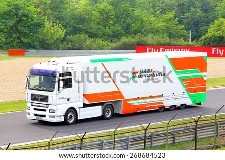 BUDAPEST, HUNGARY - JULY 27, 2014: White semi-trailer truck MAN TGA of the Sahara Force India F1 racing team at the Hungaroring Formula One Race Track.