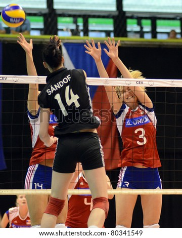BUDAPEST, HUNGARY - JUNE 18: Renata Sandor (in black 14) in action at a CEV European League woman's volleyball game Hungary vs Czech Republic on June 18, 2011 in Budapest, Hungary.