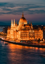 Budapest, Hungary. Night view on Parliament building over delta of Danube river. Night time blue hour.