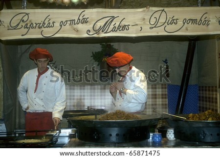 BUDAPEST, HUNGARY - NOVEMBER 24: Cooks offer their delicious food in the Christmas Market at November 24, 2010 in Budapest, Hungary. The Budapest Christmas Market is the biggest in Eastern Europe. - stock photo