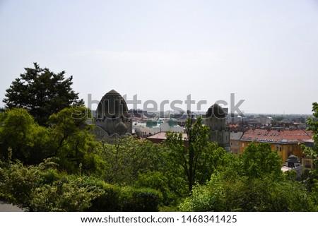Budapest, Hungary, 04.24.2019: Panoramic, skyline cityscape view of Buda with the cupolas of Gellert Thermal Bath (Gellért Gyógyfürdő és Uszoda) taken from Gellert Hill on the way to the Citadella Stock fotó ©
