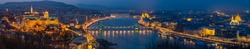 Budapest, Hungary - Panoramic skyline view of Budapest with Historic Royal Palace, Matthias Church, Szechenyi Chain Bridge, St. Stephen's Basilica and Parliament of Hungary at blue hour