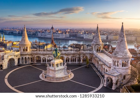 Budapest, Hungary - The famous Fisherman's Bastion at sunrise with statue of King Stephen I and Parliament of Hungary at background Stock photo ©