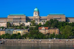 Budapest, Hungary - the Royal Palace on the banks of the Danube river on a Sunny morning against a blue sky