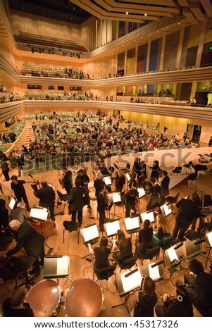 """BUDAPEST - JANUARY 23: """"Muvesz"""" Symphonic Orchestra performs on stage at MUPA on January 23, 2010 in Budapest, Hungary."""