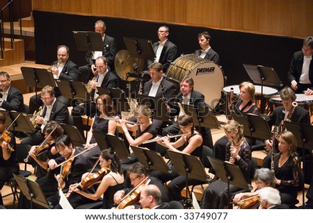 """BUDAPEST - JULY 9: MAV Symphonic orchestra concert on stage at Budapest """"Palace of Art"""" on July 9, 2009 in Budapest, Hungary."""