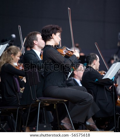 BUDAPEST - JUNE 27: Members of the Budapesti Fesztivalzenekar Phillharmonic  Orchestra perform on stage at Hosok Tere  on June 27, 2010 in Budapest, Hungary.