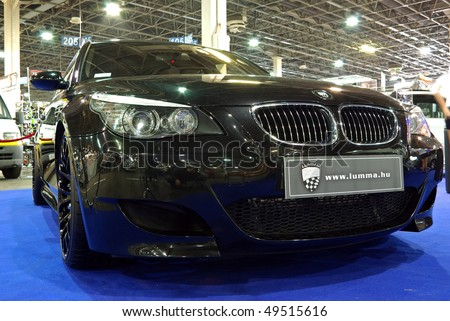 BUDAPEST - MARCH 19: Front of modified black BMW Breyton 5 GT car on international tuning show with reflector lights in Hungexpo on March 19, 2010 in Budapest, Hungary - stock photo