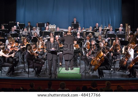 BUDAPEST - MARCH 06: Members of the MAV  Symphonic Orchestra perform on stage at Thalia Theater on March 06, 2010 in Budapest, Hungary.