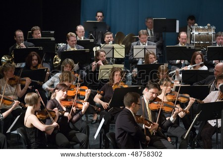 BUDAPEST - MARCH 6: Members of the MAV  Symphonic Orchestra perform on stage at Thalia Theater on March 06, 2010 in Budapest, Hungary.