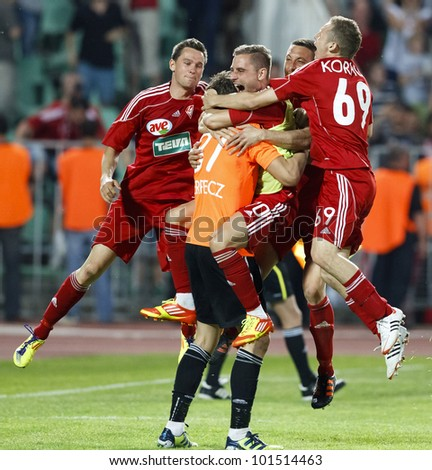 BUDAPEST - MAY 1: The team-mates of DVSC celebrate the goalie Verpecz after his save during MTK vs. DVSC Hungarian Cup Final football game at Puskas Stadium on May 1, 2012 in Budapest, Hungary