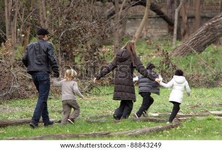 BUDAPEST - NOVEMBER 5: Brad Pitt and Angelina Jolie take their children Pax, Zahara and Shiloh to a park in Budapest, Hungary, on Friday,  November 5, 2010.  Jolie is filming In The Land Of Blood And Honey In Budapest.
