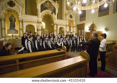 BUDAPEST-OCTOBER 6: Members of the Boy Choir of Munkacs perform at an Greek Catholic Church (conductor: Volodimir Volontir) October 6, 2009 in Budapest, Hungary
