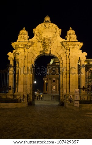 Budapest, ornate arched gateway to the Buda Castle Or Royal Palace at night
