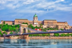 Budapest Royal Castle and Szechenyi Chain Bridge at day time from Danube river, Hungary.