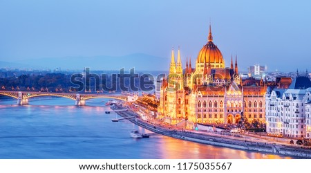 Budapest skyline, Hungary - illuminated Hungarian Parliament in twilight. Spectacular Panoramic view on Danube river delta and bridge. Famous European travel destination.